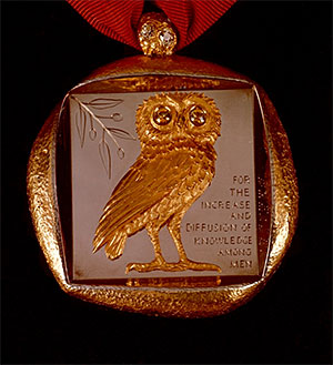 Badge of Office with owl and mission statement.