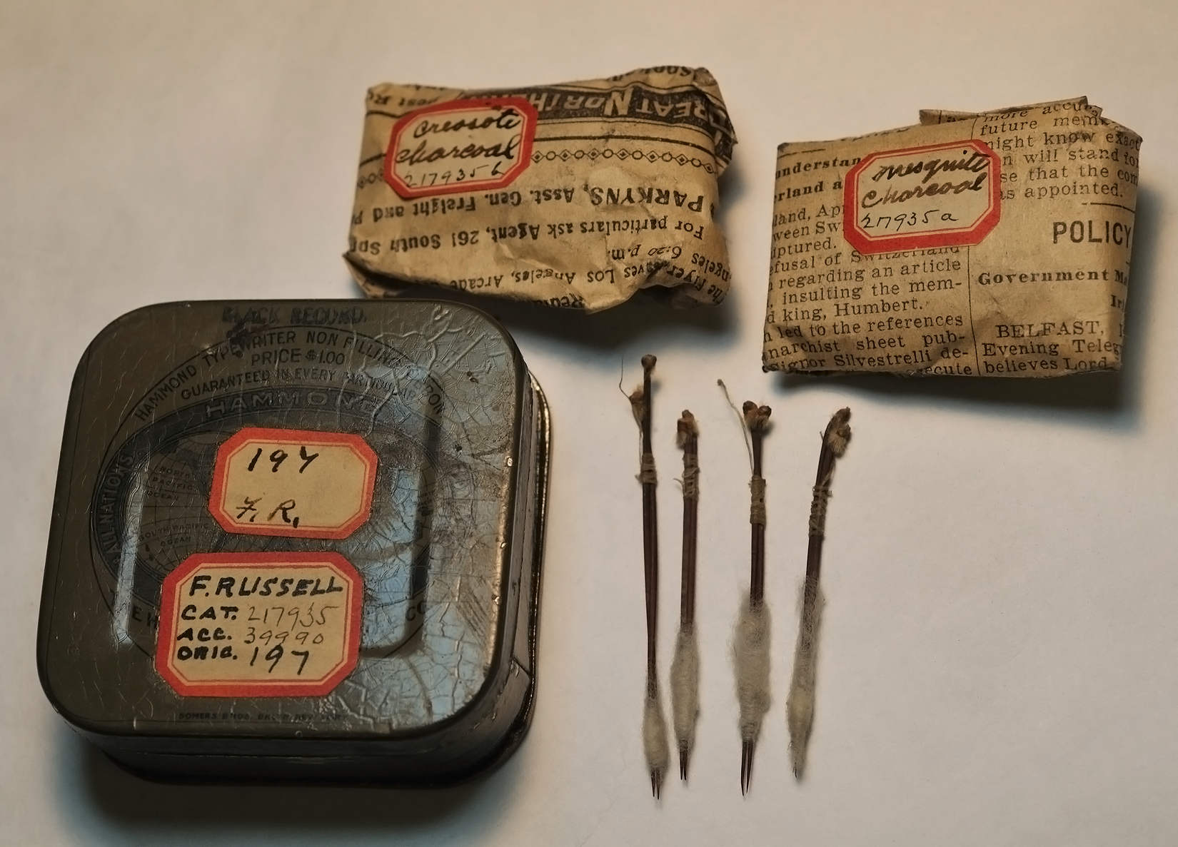 Akimel O'odham (Pima) tattooing kit from Arizona collected by Frank Russell, ca. 1900. Tattoos were made using cactus spines tied together with cotton. Creosote and mesquite charcoal were rubbed into the wounds. (Image courtesy Department of Anthropology, Smithsonian Institution)
