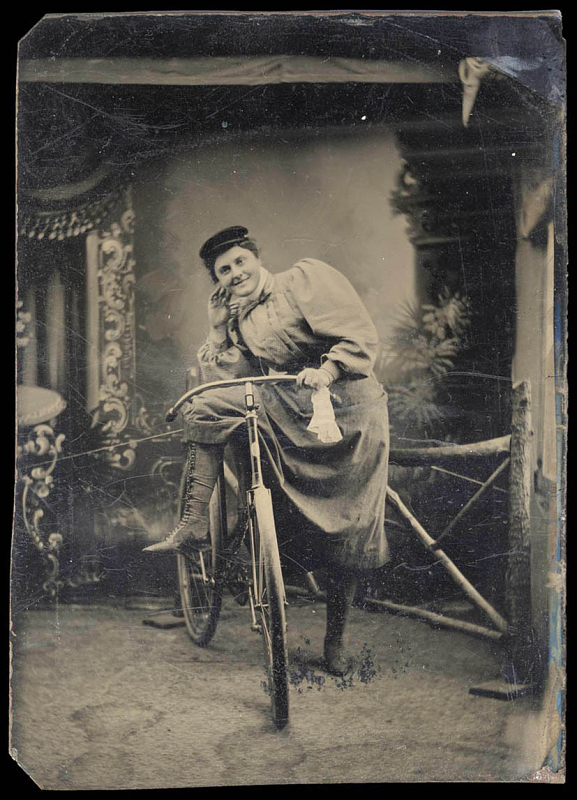 woman in a dress on a bicycle.