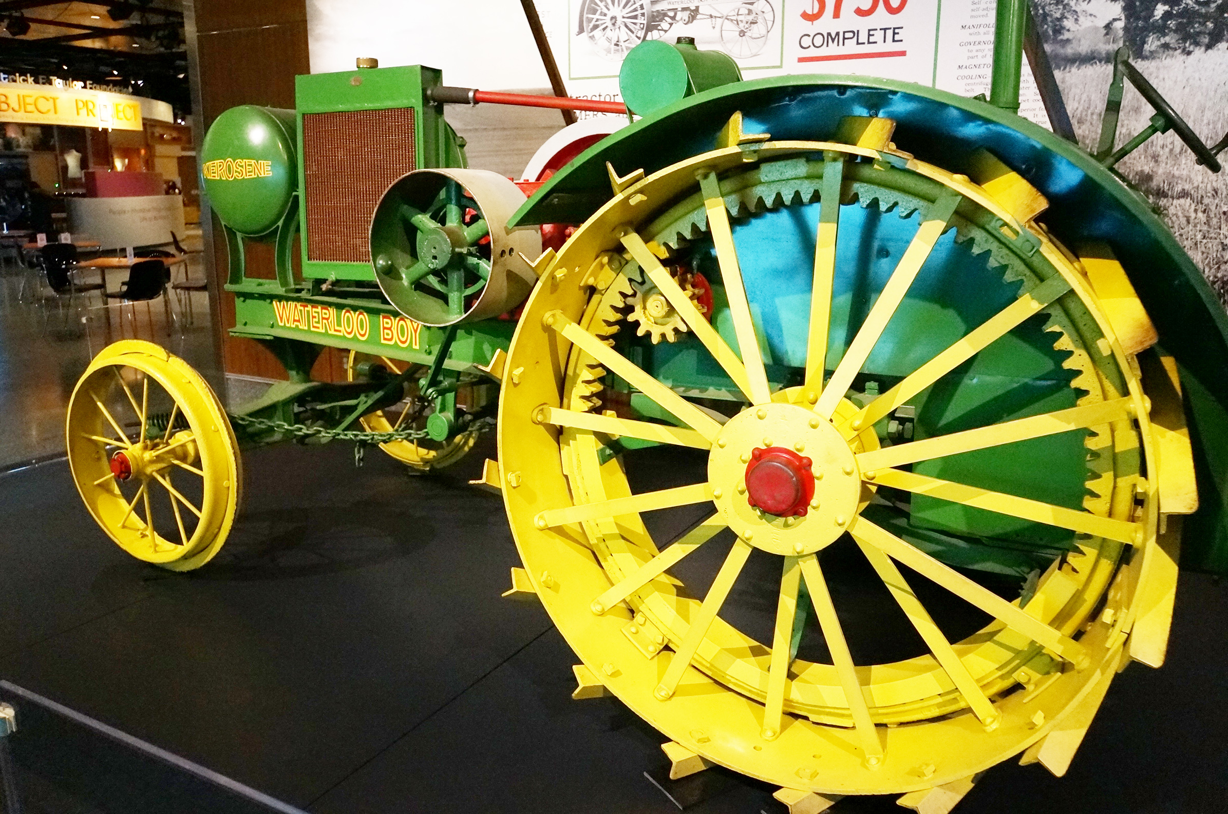 green tractor with large yellow spoked wheels