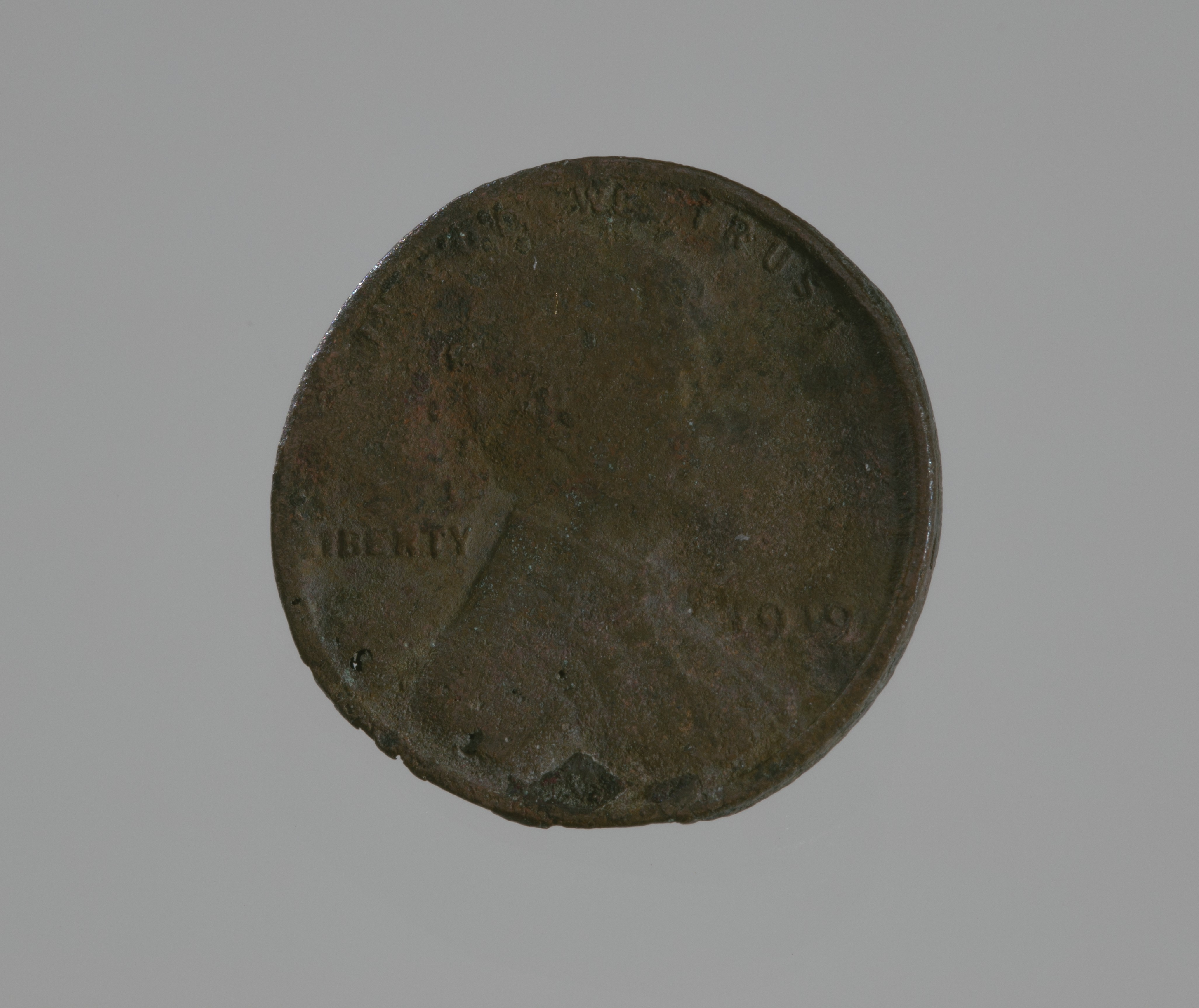 A 1919 penny. Its face is partially melted.