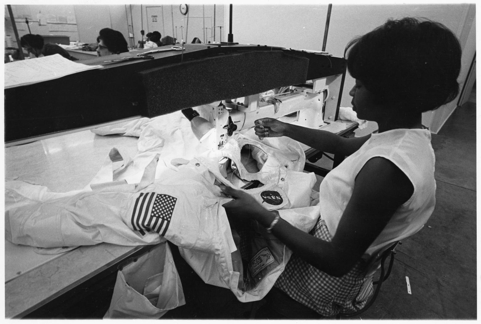 Seamstress Hazel Fellows sewing a space suit
