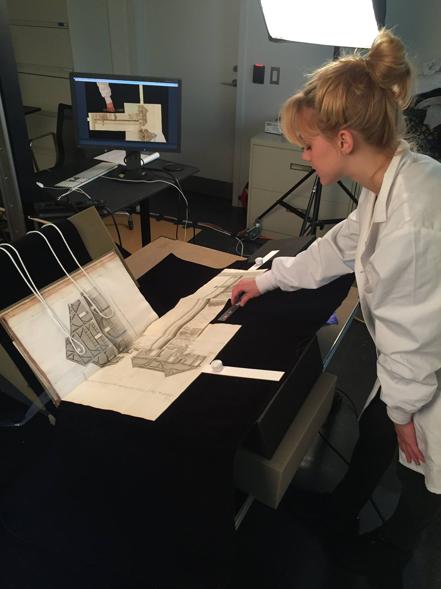 Woman digitizes an image from a book