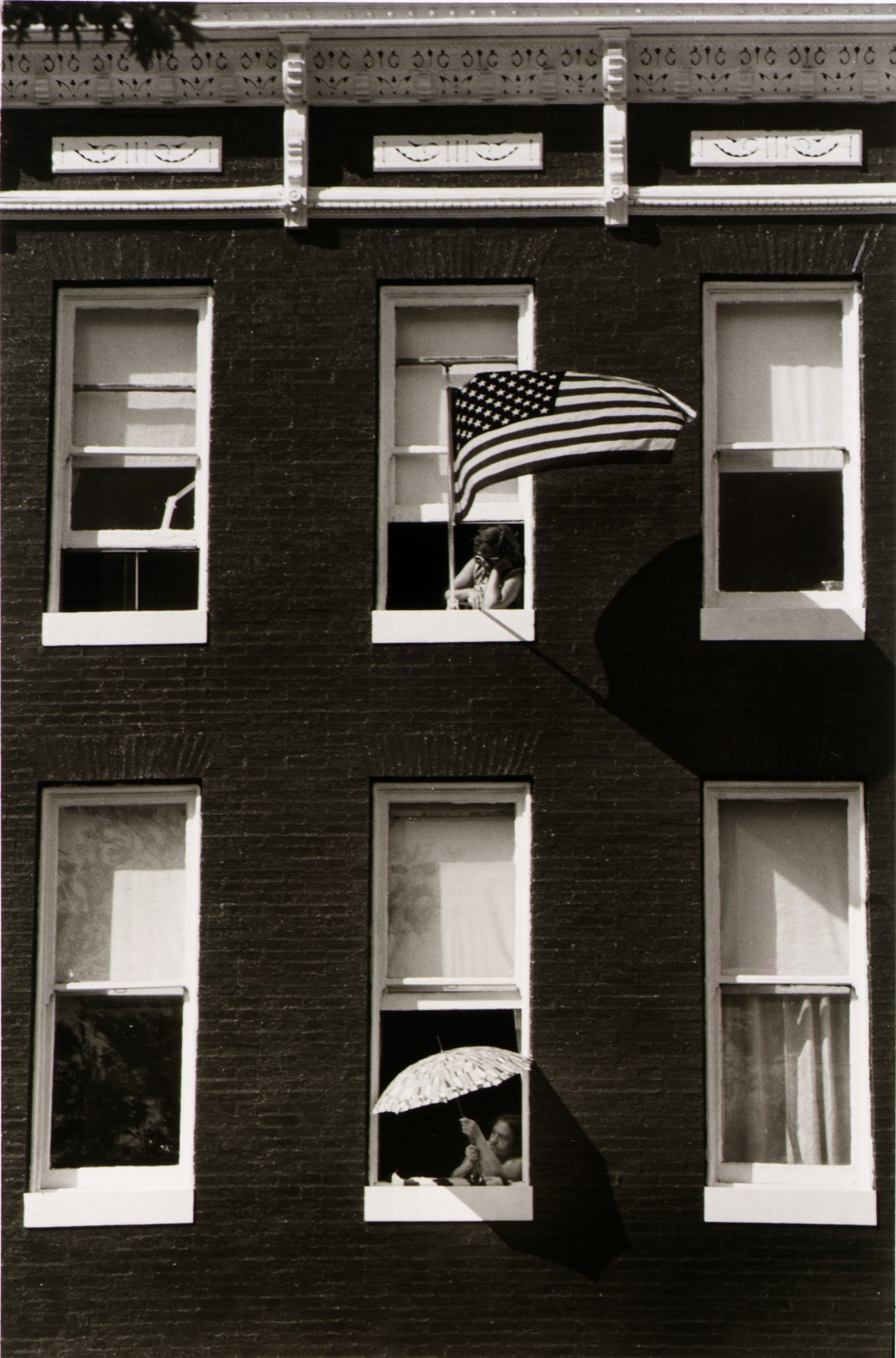 Apartment building with an American flag flown out of a window