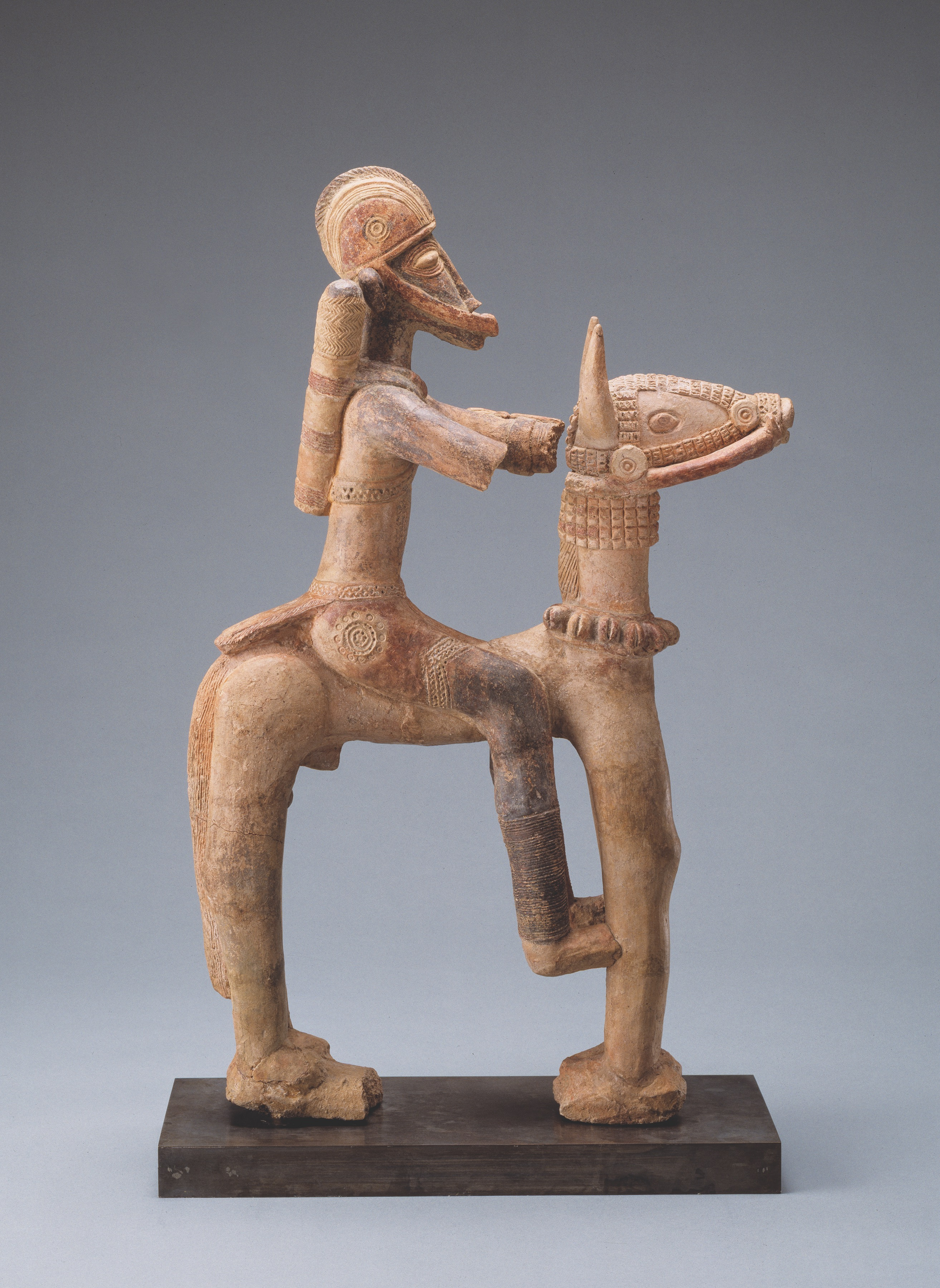 Sculpture of man sitting on a camel