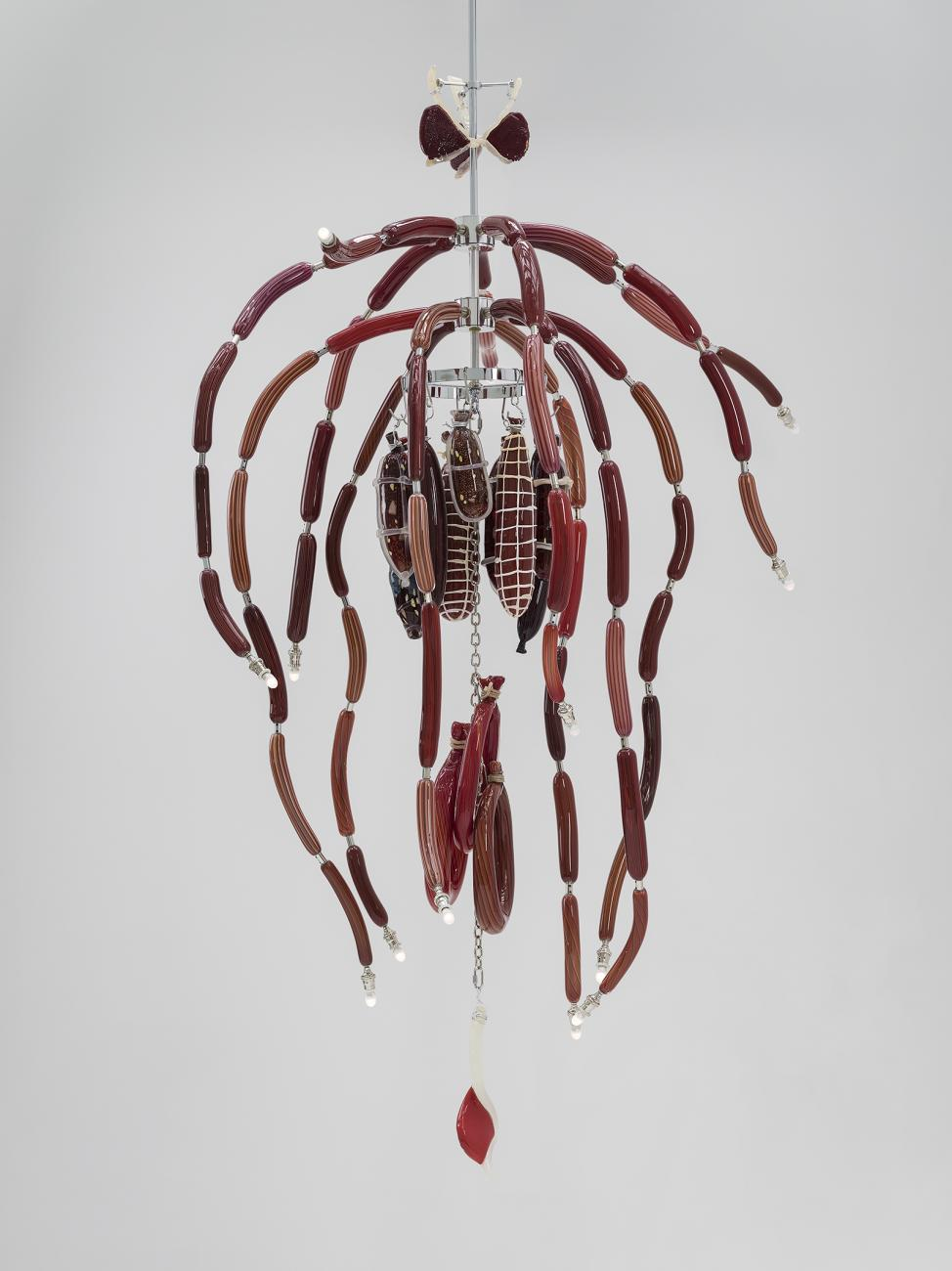 Glass chandelier made to look like hanging meat