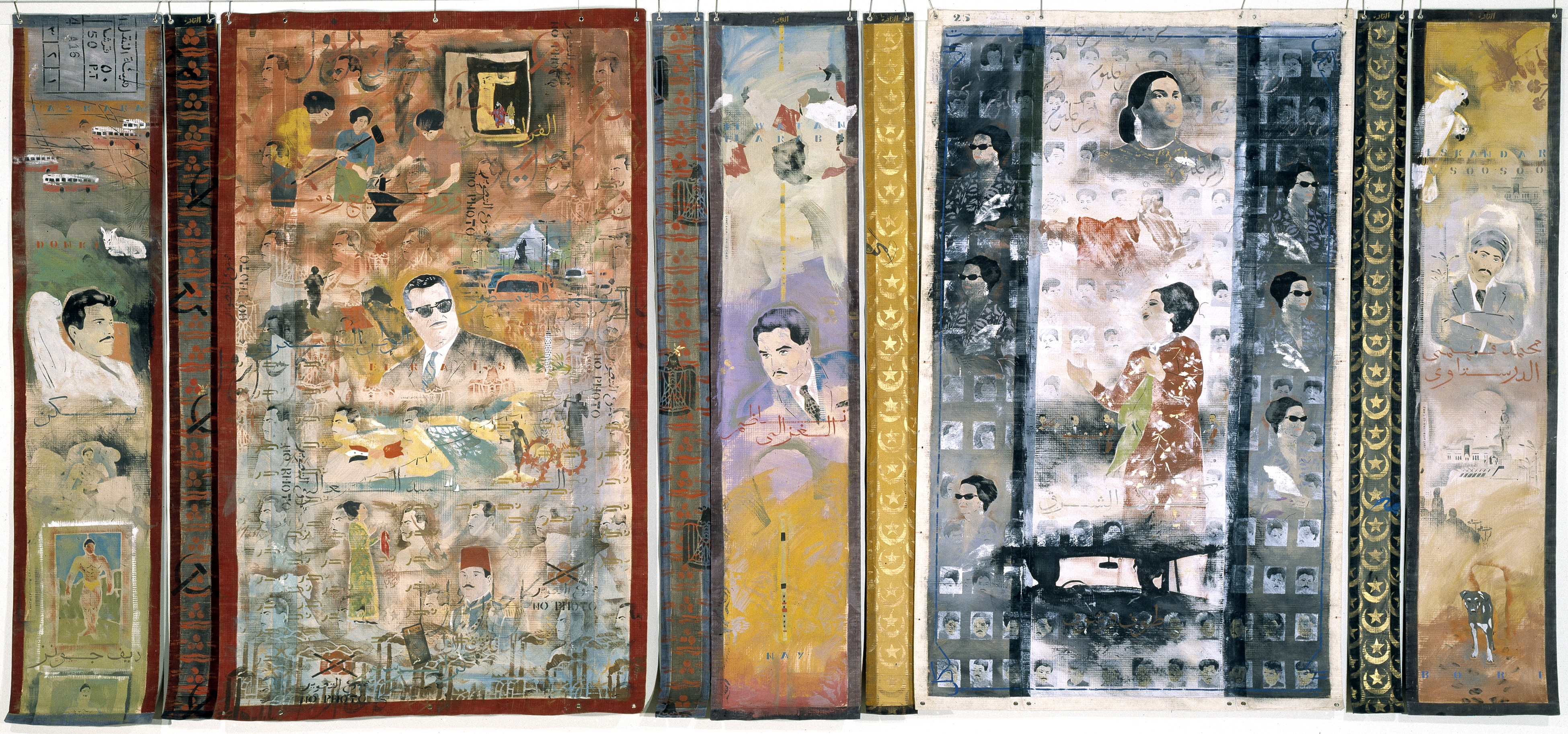 Colorful wall art with depictions of people and urban scenes.