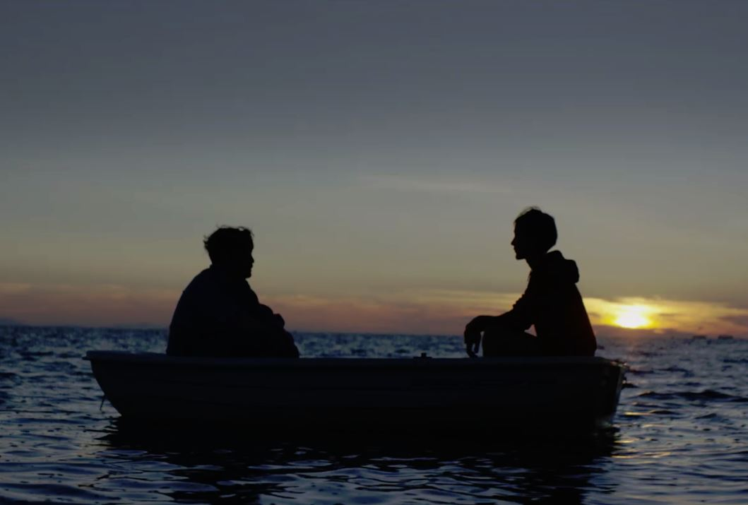 Two people in rowboat