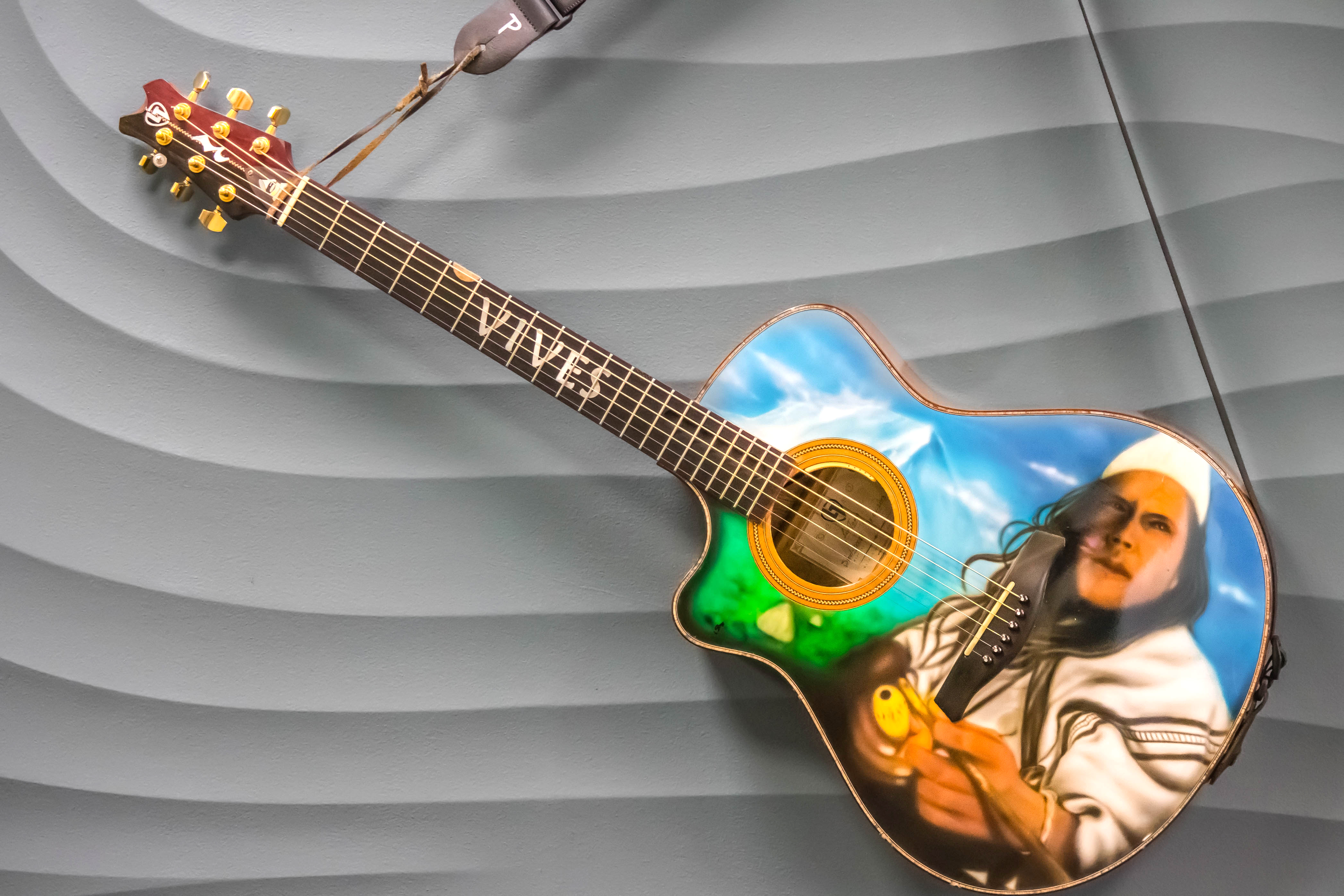 Guitar with portrait of Vives painted on it