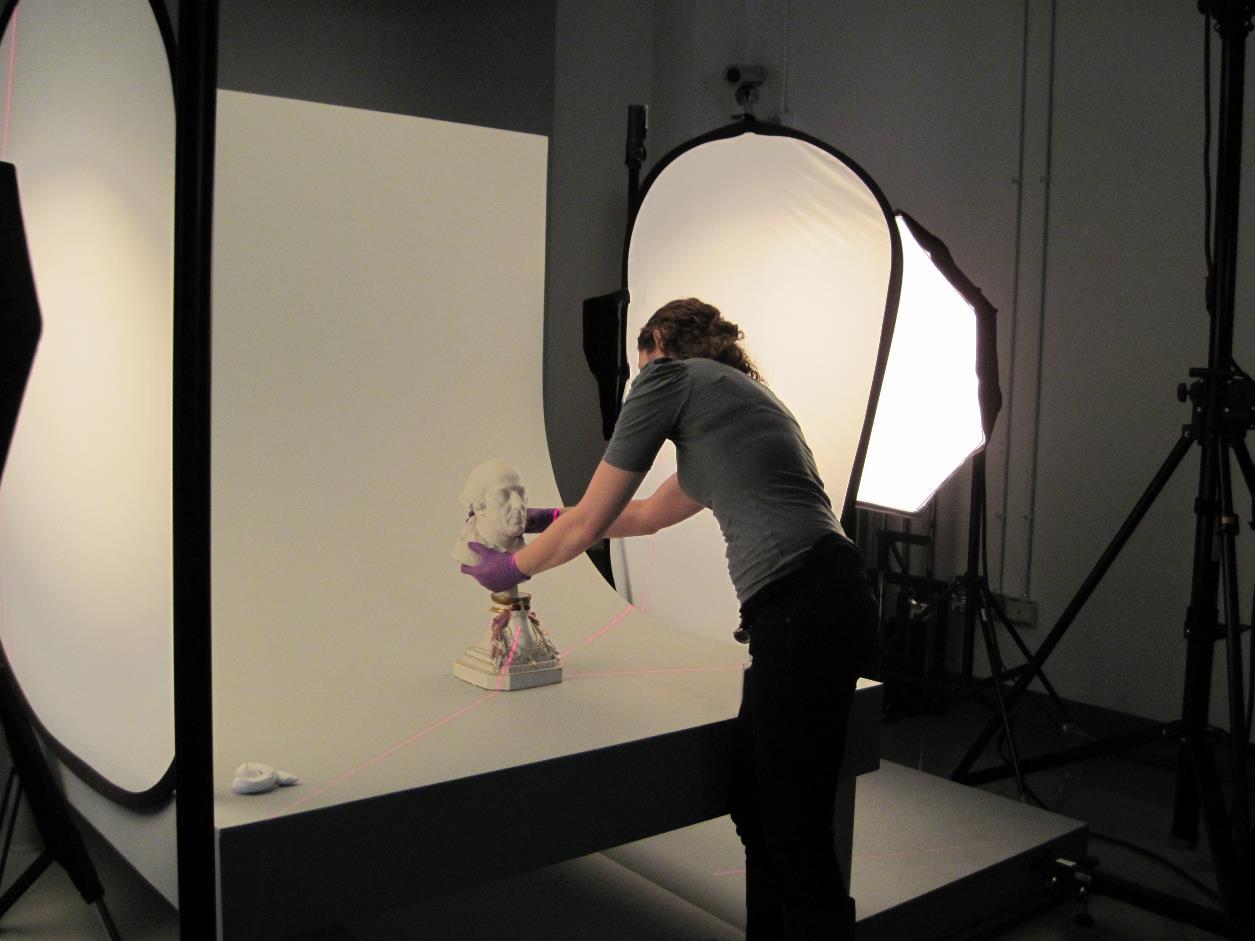 Technician preparing bust for digitization