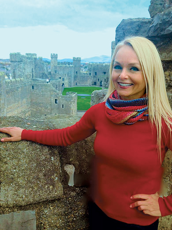 Christine van Blokland getting curious at Caernarfon Castle in Wales (Curious Tr
