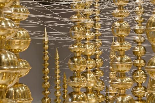 Detail of art installation featuring golden pots