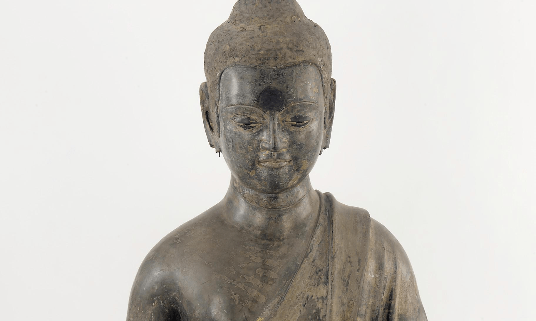 Cropped close up of Laquer Buddha
