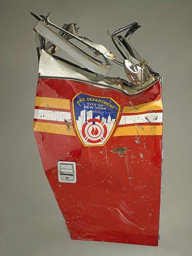 Red, dented New York City fire truck door