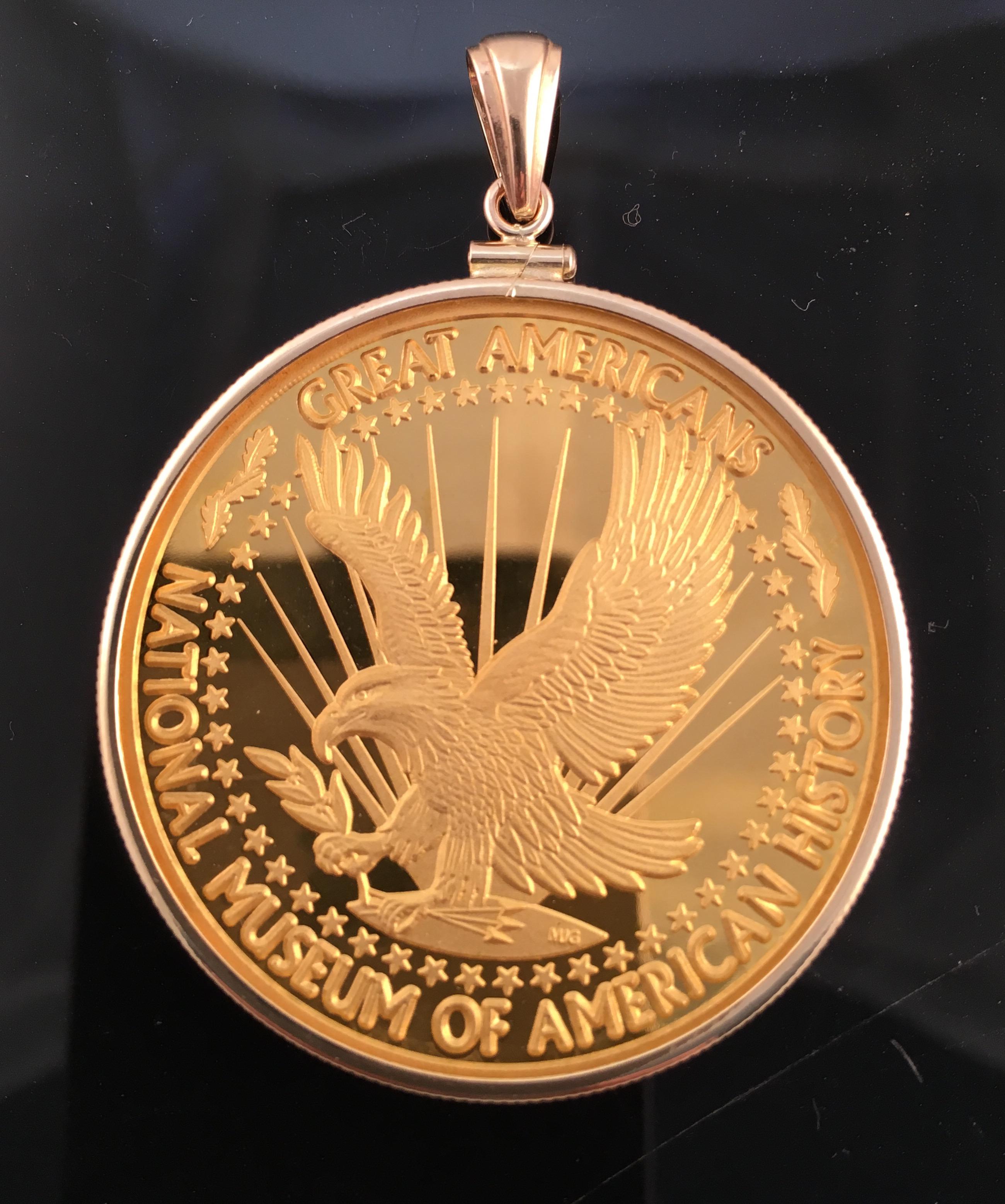 Gold medal displayed black background