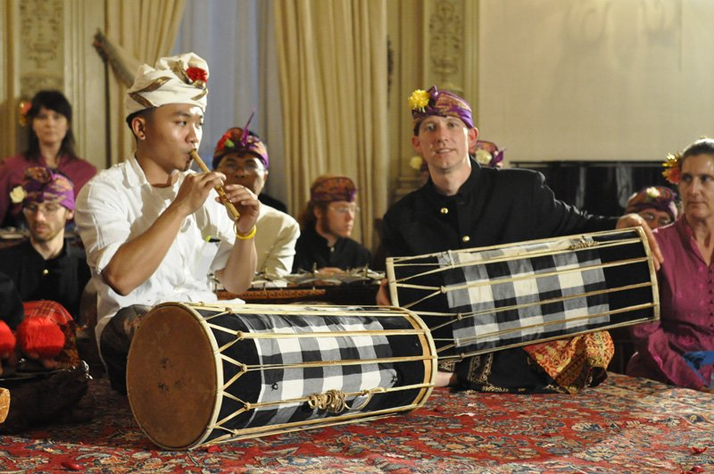 Seated performers with drums