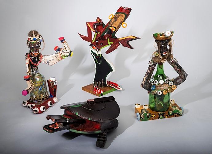 Several mixed media folk art sculptures