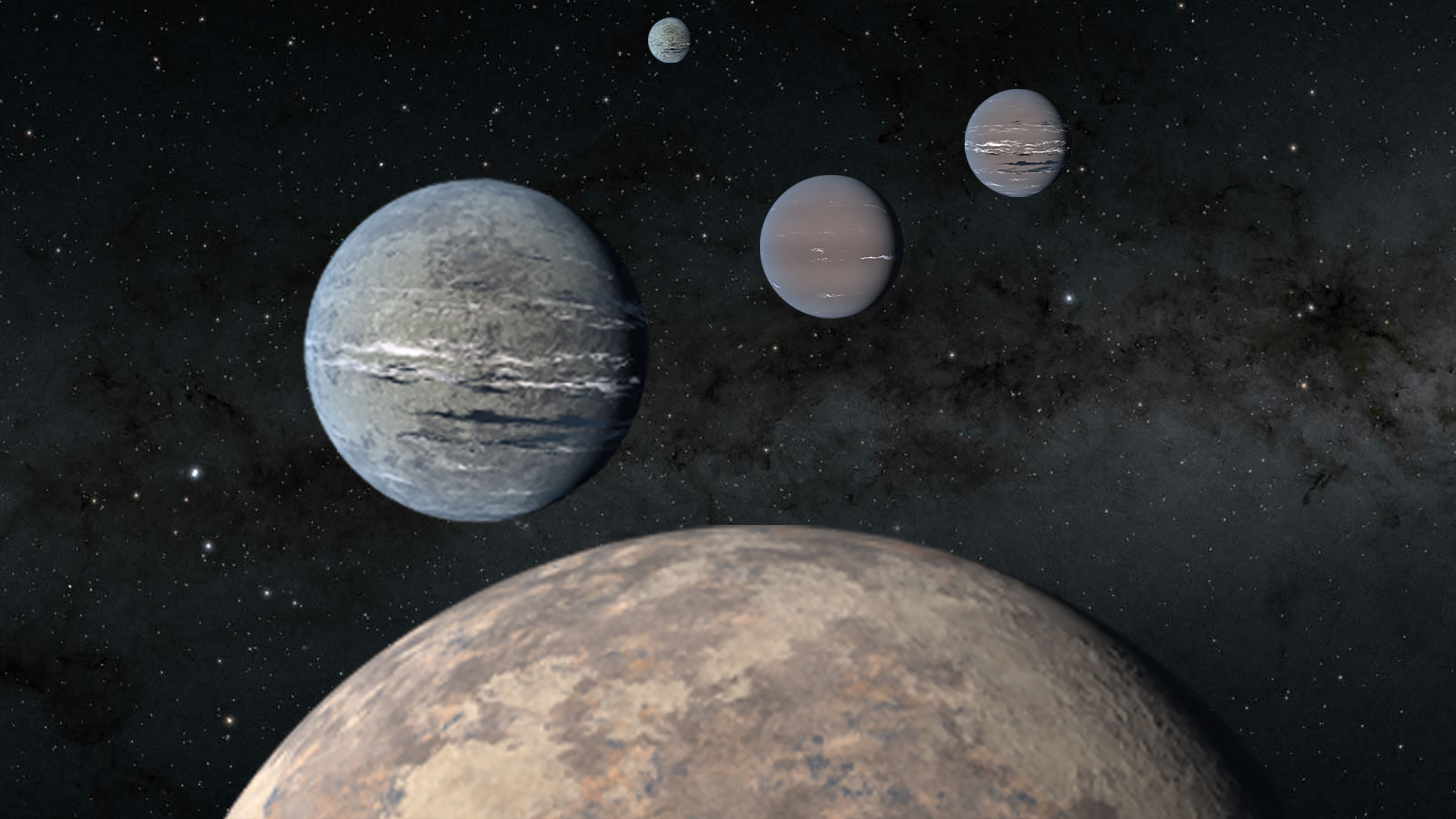 Artist rendering of 5 planets of varying sizes