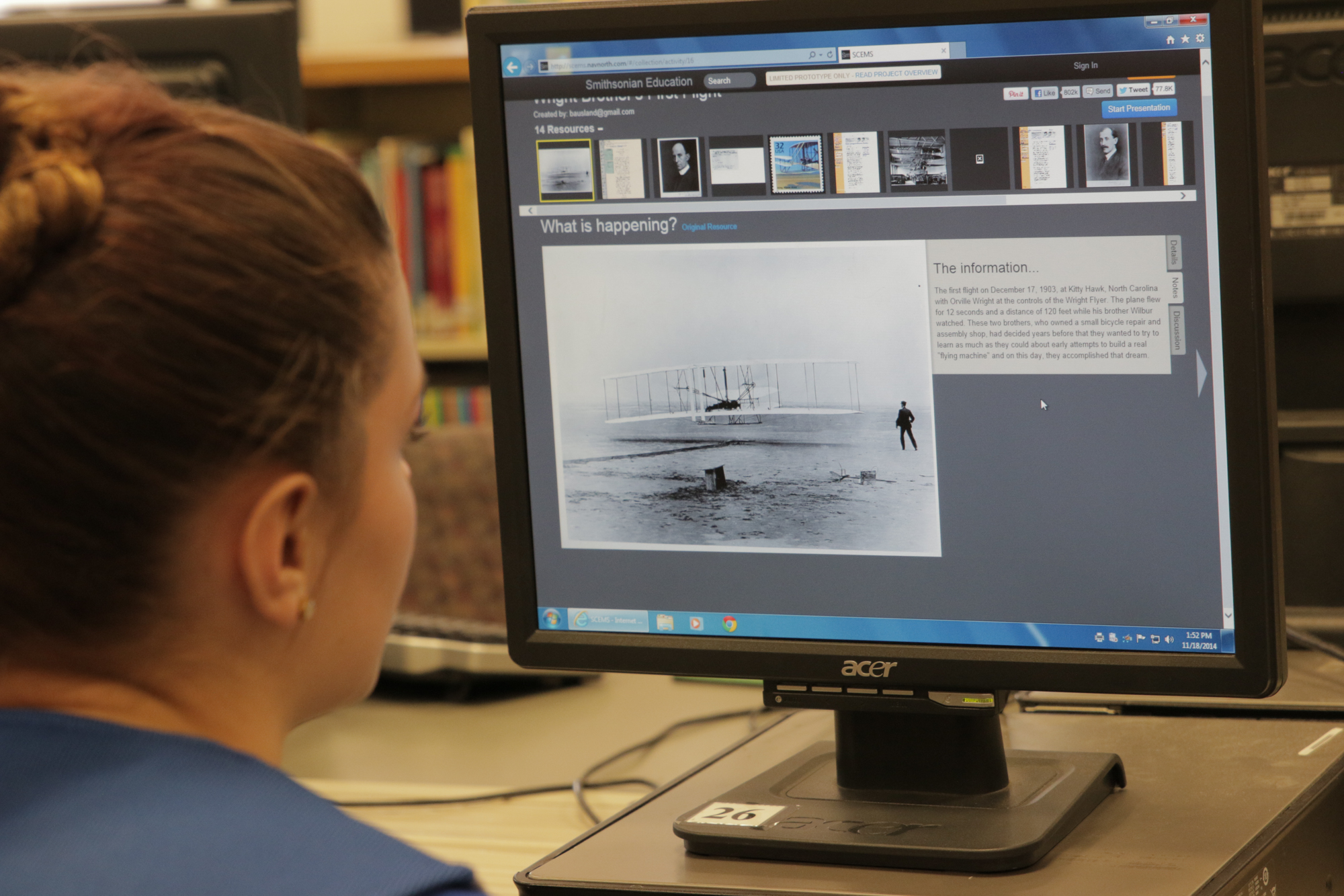 Child looking at monitor showing Wright brothers