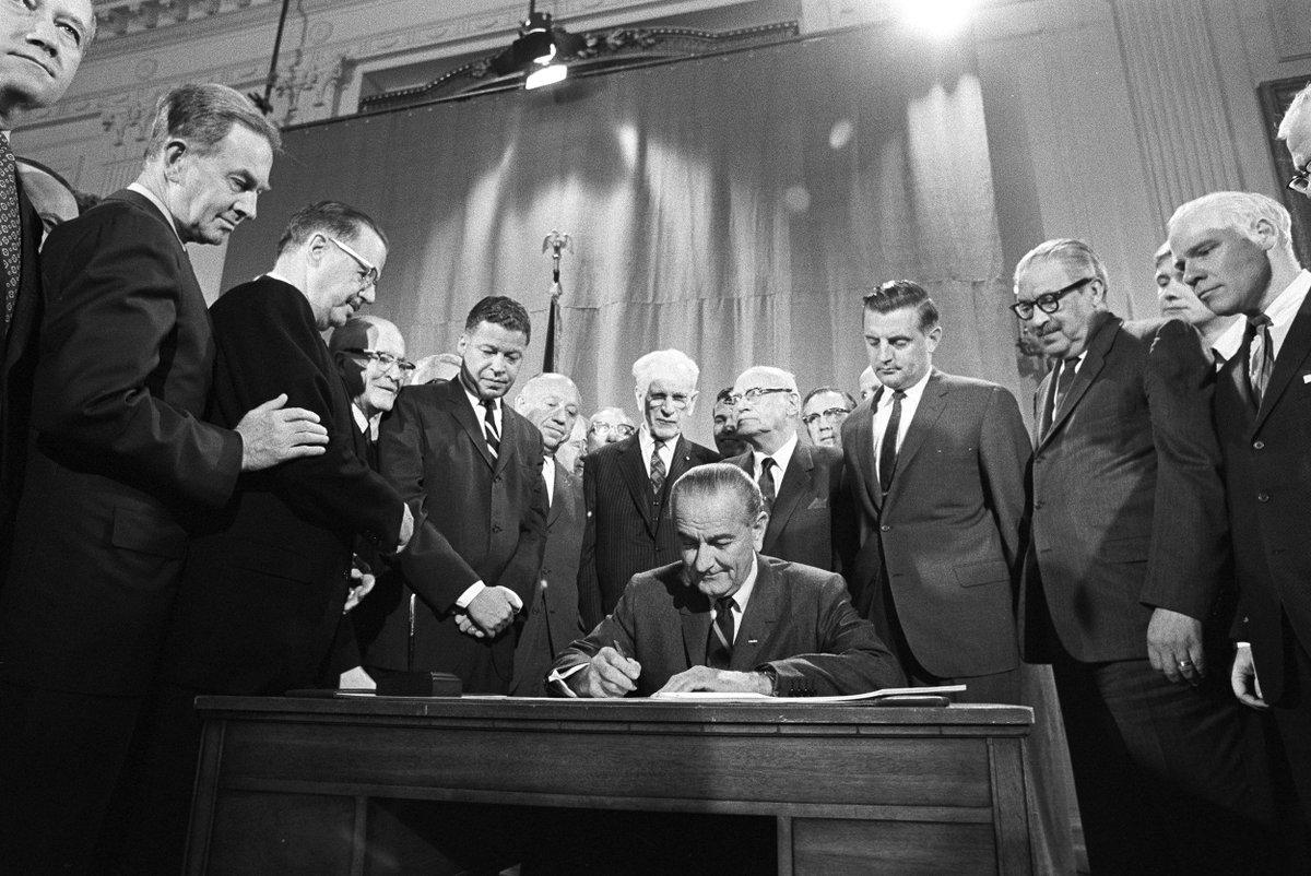 President Lyndon Johnson signs CIvil Rights Act of 1964