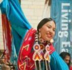 Native American woman dancing in traditional attire