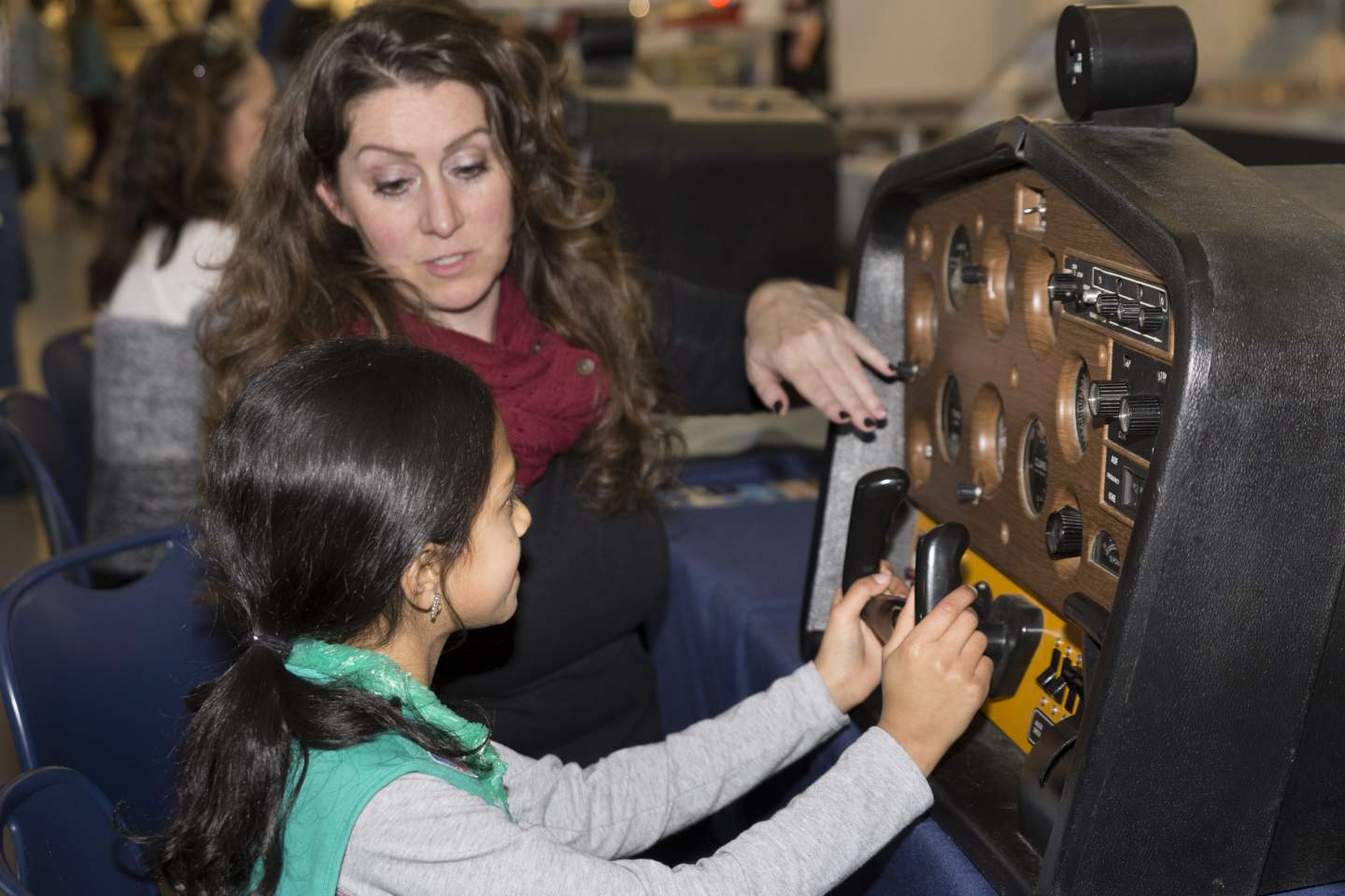 female student using flight simulator