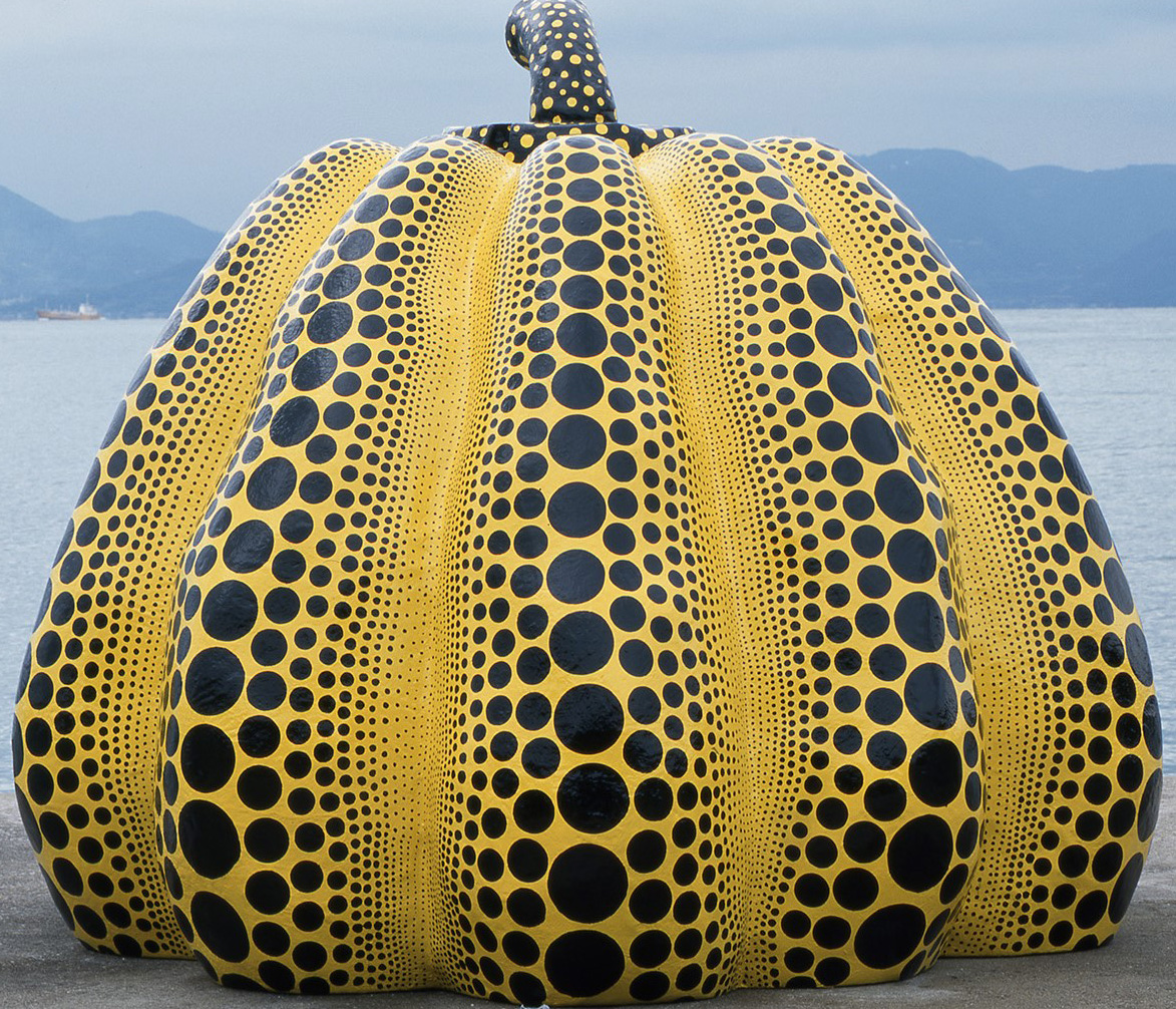 Giant yeallow and black pumpkin sculpture