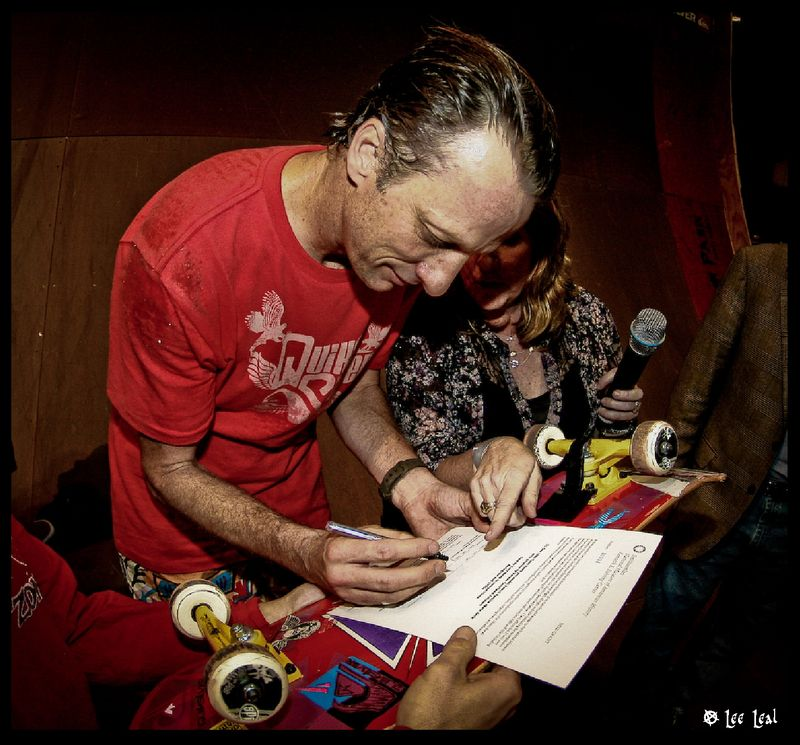 Tony Hawk signing a deed of gift