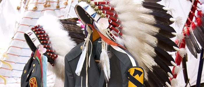 Eagle feather headdresses and uniforms at memorial