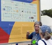 Volunteer and signage at Smithsonian Folklife Festival