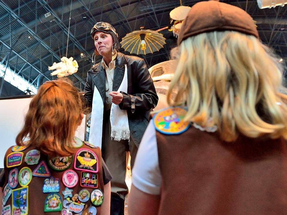 Girl scouts looking at exhibition