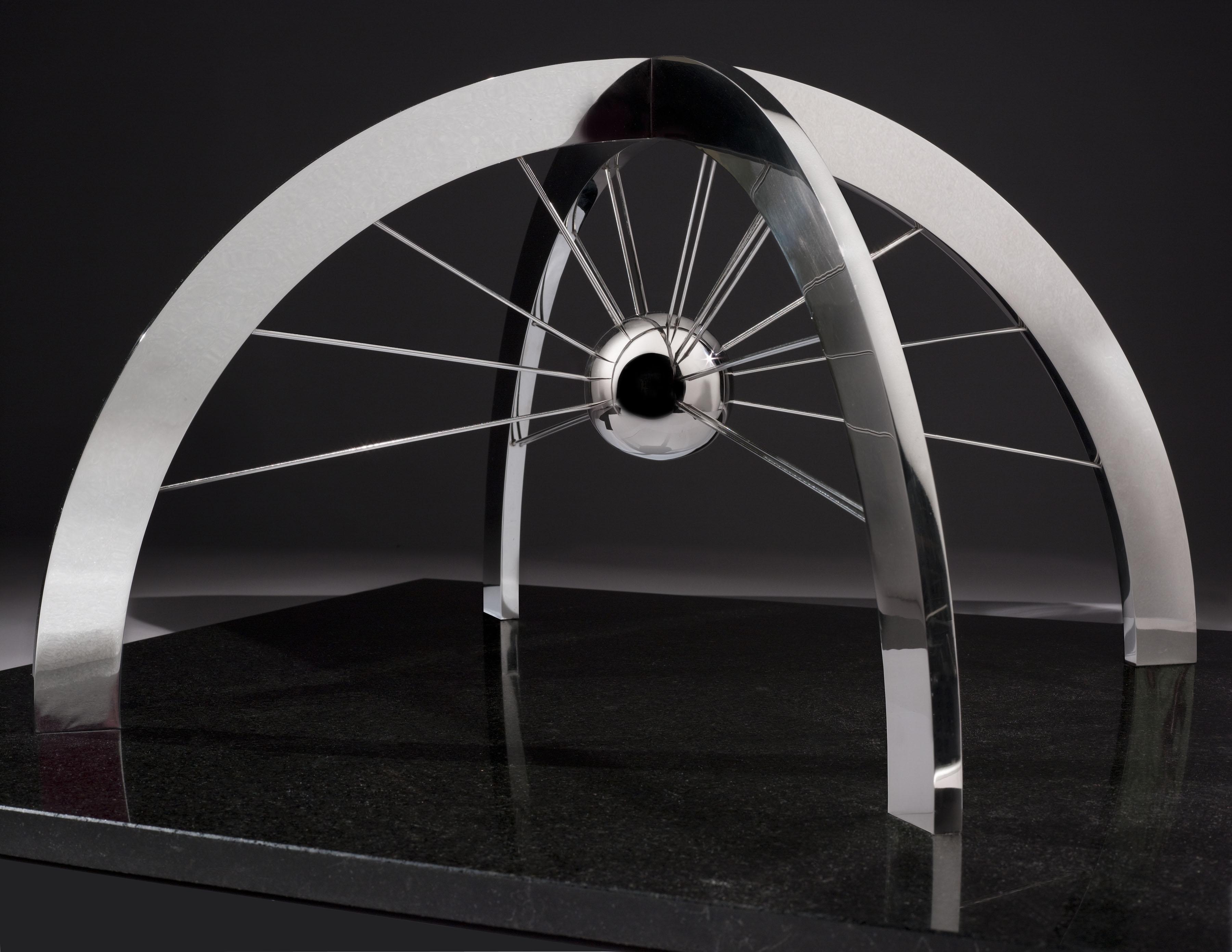 "Arcing metallic sculpture ""The Web of Space"""