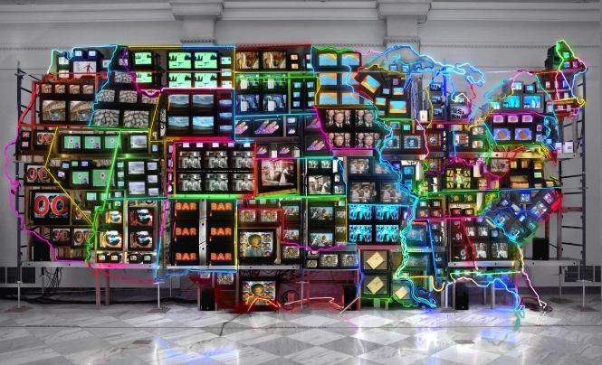 Neon sculpture of the United States composed of televisions