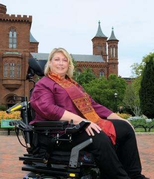 Beth Ziebarth in front of the Smithsonian Castle