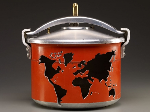 Red pressure cooker with image of a world map carved in the side