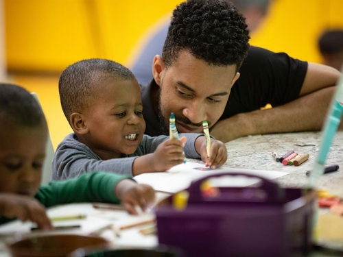 Parent and child creating art at the National Museum of African American History and Culture.