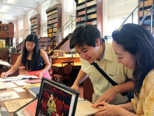 young adults researching books and imagery