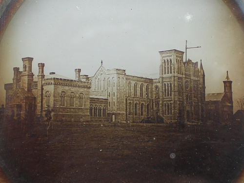 Lantern slide with earliest known photo of the Smithsonian Castle.