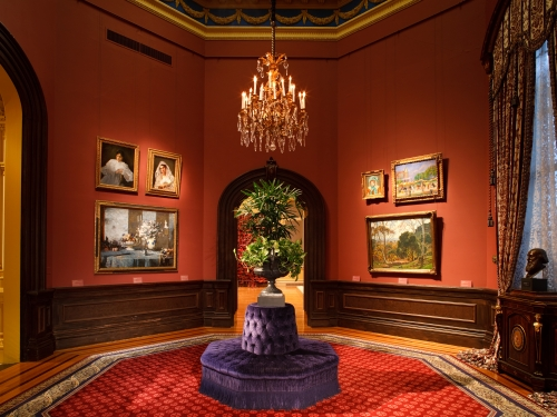 Room in Renwick Gallery with chandelier and paintings