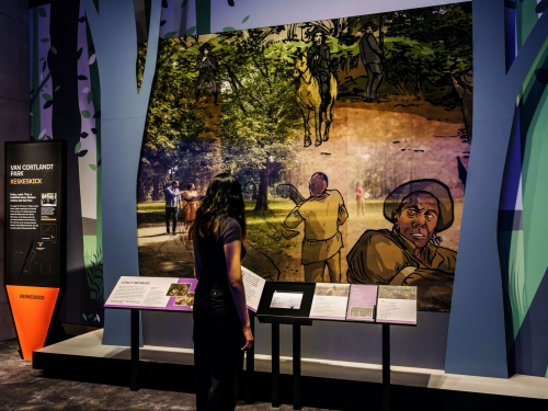 Person interacting with museum exhibit