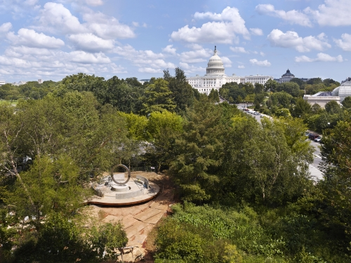 The Native American Veterans Memorial seen from above, with the Capitol in the background