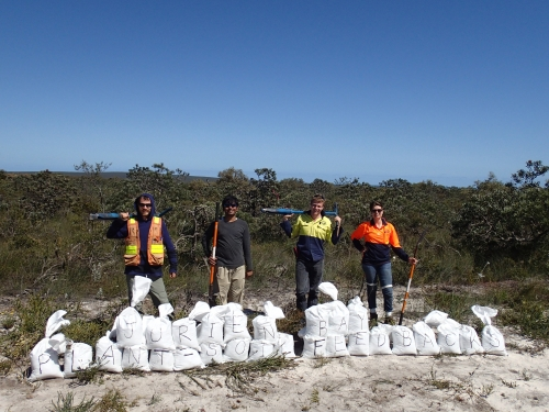 Researchers with bags of soil samples