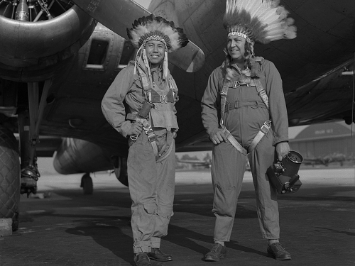 Gus Palmer and Horace Poolaw wearing headdresses