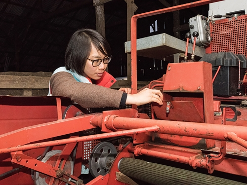 Woman examines equipment