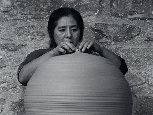 Woman with clay pot