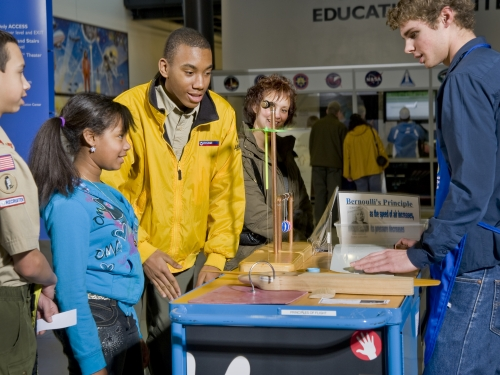 Young people at exhibit display