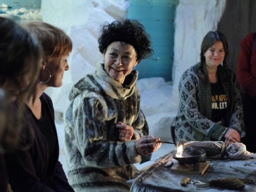 Still from film Angry Inuk showing group of women talking
