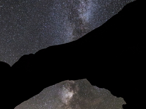 Starlit sky seen through natural arch
