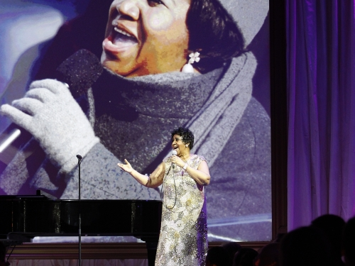 Franklin with Inauguration performance on screen
