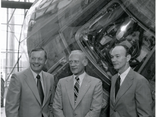 B&W photo of 3 astronauts with command module